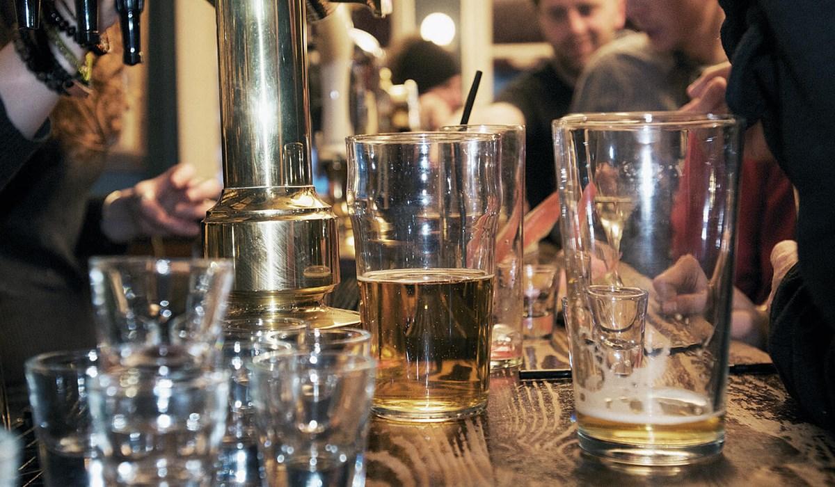 Public bar full of drinks glasses